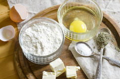 Ingredients for the dough: eggs, flour, butter, salt Stock Image