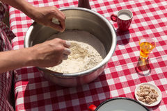 Ingredients for an dough with hands Stock Photo
