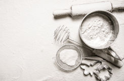 Ingredients for dough - sieve flour, rolling pin, cookie cutters. Stock Photos