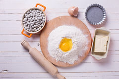 Ingredients for dough on wooden board Stock Image