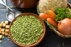 Ingredients for dried split pea vegetarian soup. Ingredients for dried split pea vegetarian soup - carrot, celery root, onion, parsley Royalty Free Stock Photography