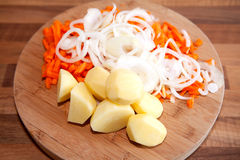 Ingredients for Dutch hutspot stew on wooden cutting board Stock Photography