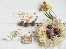 Ingredients Easter and chocolate eggs. On white wooden table,holiday concept and preparation Royalty Free Stock Images