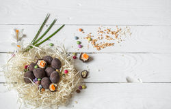 Ingredients Easter and chocolate eggs. On white wooden table,holiday concept and preparation Stock Image