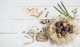 Ingredients Easter and chocolate eggs. On white wooden table,holiday concept and preparation Stock Photos