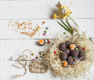 Ingredients Easter and chocolate eggs. On white wooden table,holiday concept and preparation Royalty Free Stock Image