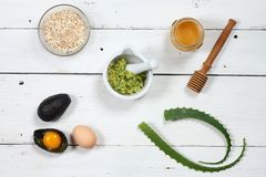 Ingredients for face mask; avocado, aloe vera, egg, oatmeal, honey stock photography