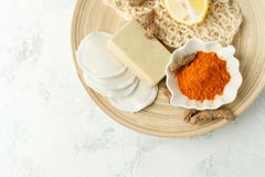 Ingredients for Face Mask with turmeric powder, spa procedures for skin health. Organic wellness treatment - curcumin powder, soap. Sponge, natural massage stock photos