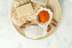 Ingredients for Face Mask with turmeric powder, spa procedures for skin health. Organic wellness treatment - curcumin powder, soap. Sponge, natural massage royalty free stock image