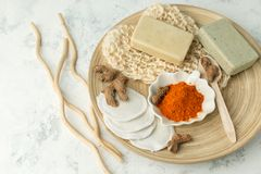 Ingredients for Face Mask with turmeric powder, spa procedures for skin health. Organic wellness treatment - curcumin powder, soap. Sponge, natural massage royalty free stock photo