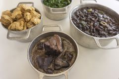 Ingredients of feijoada, typical food of Brazil. On white background royalty free stock photography
