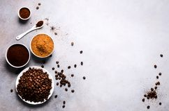 Free Ingredients For Making Caffeine Drink - Brown Coconut Sugar, Coffee Beans, Ground And Instant Coffee On Light Concrete Stock Photo - 114351380