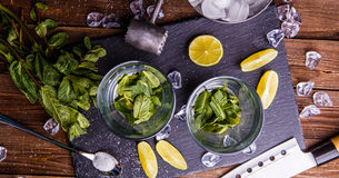 Ingredients for fresh cocktail mojito. On black stone board Stock Photos