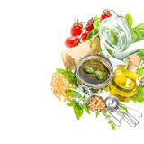 Ingredients for fresh green pesto sauce on white background Royalty Free Stock Photos