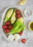 Ingredients for a fresh salad with avocado, cherry tomatoes and cheese Royalty Free Stock Photos