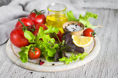 Ingredients for a fresh salad with tomatoes and garden herbs Stock Photos