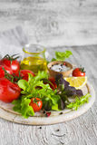 Ingredients for a fresh salad with tomatoes and garden herbs Stock Images