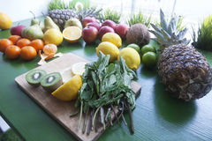 Ingredients for fresh smoothie or juice. On the wood green background Stock Images