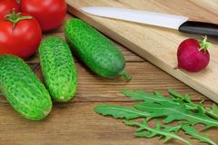 Ingredients of Fresh Vegetable Salad, Kitchen Knife And Cutting Royalty Free Stock Photography