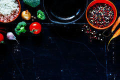 Ingredients. Fresh vegetarian ingredients for cooking and spices on dark vintage background with space for text. Diet concept. Vegetarian food, health or cooking stock image