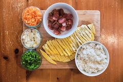 Ingredients for Fried Rice - Pork Sausages, Carrots, Beans, Rice and Omelette. Ingredients for Fried Rice - Pork Sausages, Carrots, Beans, Rice and Omelette on stock photos
