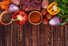 Ingredients for goulash or stew cooking: raw meat,herbs,spices,v Stock Image