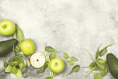 Ingredients for green smoothie - apples, spinach, celery, avocad. O on a light background. Top view, copy space. Food background. Toning Royalty Free Stock Images