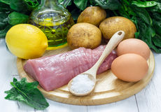 Ingredients for green soup with spinach meat, potato and egg (green borscht) Royalty Free Stock Photos
