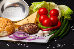 Ingredients for hamburger on a dark background. Stock Photography