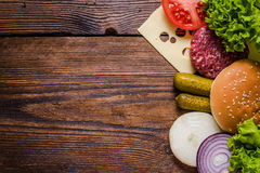 Ingredients for hamburgers on wooden table, border background Stock Photo
