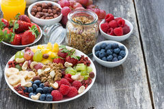 Ingredients for a healthy breakfast - berries, fruit, muesli Stock Photography