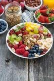 Ingredients for a healthy breakfast - berries, fruit, muesli Stock Image