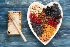 Ingredients for healthy breakfast.  berries, nuts, granola, dried fruits, honey Royalty Free Stock Images