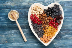 Ingredients for healthy breakfast.  berries, nuts, granola, dried fruits, honey Royalty Free Stock Image