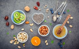 Ingredients for a healthy foods background, nuts, honey, berries Royalty Free Stock Image