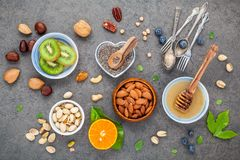 Ingredients for a healthy foods background, nuts, honey, berries Stock Photo