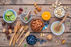 Ingredients for a healthy foods background, nuts, honey, berries. Fruits, blueberry, orange, almonds, walnuts and chia seeds .The concept of healthy food set Stock Photos
