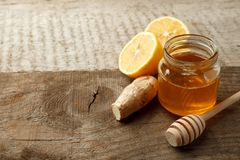 Ingredients for herbal medicine lemon, ginger, honey. Natural products to support the immune system in winter, vintage wooden back. Ground, copy space royalty free stock images