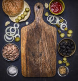 Ingredients for homemade burger with tuna, laid out around a cutting board  on wooden rustic background top view border, place for Stock Image