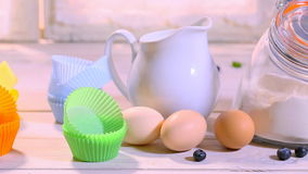 Ingredients for homemade cupcakes with blueberries stock video footage