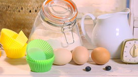 Ingredients for homemade muffins with blueberries stock video footage
