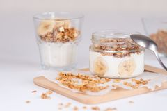 Ingredients for homemade oatmeal granola in glass jar. Oat flakes, honey, raisins and nuts. Healthy breakfast concept stock image