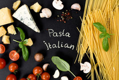 Ingredients for homemade pasta. On a black background Stock Photos