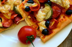 Ingredients for homemade pizza with fresh tomatoes, peppers, olives, mushrooms and cheese Royalty Free Stock Image
