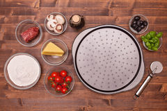 Ingredients of a homemade pizza Royalty Free Stock Photography
