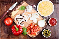 Ingredients of homemade pizza on trencher Stock Photo