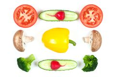 Ingredients for homemade pizza on white background. Top view. Ingredients for pepper, slices mushrooms, slices tomatoes, cucumbers. Broccoli and salad royalty free stock photography