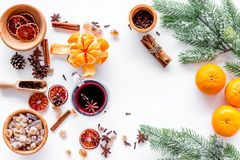 Ingredients mulled wine or grog with spices and citrus for winter evening. Christmas new year eve. White background top Stock Photography