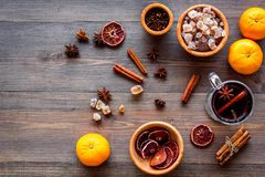 Ingredients mulled wine or grog with spices and citrus for winter evening. Christmas new year eve. Wooden background top Royalty Free Stock Image