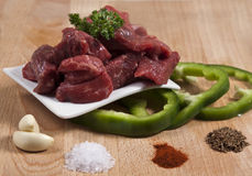 Ingredients for a Hungarian goulash on a chopping. Composition containing some of the key ingredients for a Hungarian goulash Stock Photo